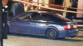 A CCTV still of a blue Ford Mondeo