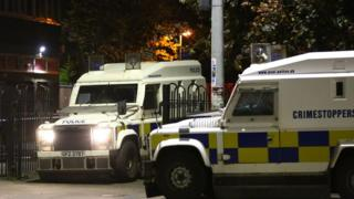Police at the scene of the Divis flats death
