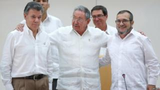 Cuban President Raul Castro (centre) facilitated the first meeting between Mr Santos (left) and Timochenko (right) last month