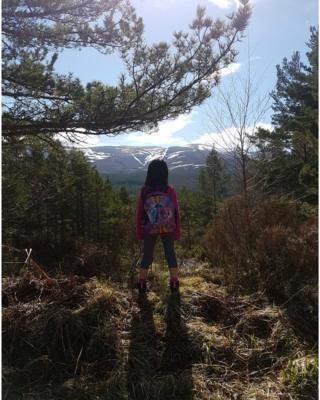 girl hiking to Lochan Uaine in Glenmore