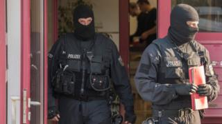 Federal police officers raid a brothel in Maintal, western Germany in April 2018