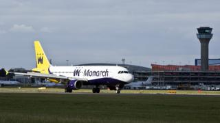 Monarch plane on ground