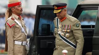 Pakistan's army chief General Qamar Javed Bajwa seen exiting a vehicle at the Pakistan Day military parade in March