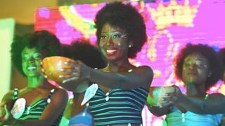 in_pictures Miss Nappy contestants hold out bowls during the event in Abidjan, Ivory Coast - Saturday 16 November 2019