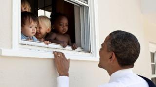President Obama smiles at children in Maryland