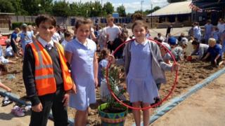 Children at Banks Road Primary School in Garston bring the beach to the playground