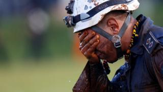 A member of rescue team reacts, upon returning from the mission, after a tailings dam owned by Brazilian mining company Vale SA collapsed