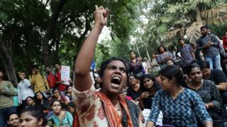A student shouts slogans during a protest against the scrapping of the special constitutional status for Kashmir by the government, in Delhi, India, August 8, 2019