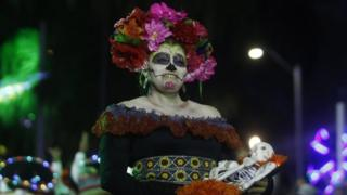 in_pictures A woman dressed as a Mexican catrina poses for a photo in Medellín