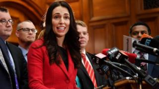 New leader of the Labour Party Jacinda Ardern (C) speaks with her front bench at her first press conference at Parliament in Wellington on August 1, 2017