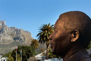 A bronze statue of late South African president and anti-apartheid campaigner Nelson Mandela is seen in the foreground, while the backdrop is Cape Town's distinctive Table Mountain.