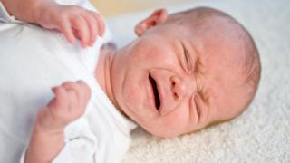 A baby with colic who is crying excessively