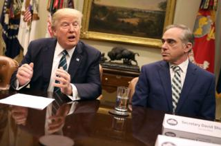 Mr Shulkin sitting next to Trump