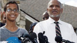 Ahmed Mohamed, 14, left, and his father, Mohamed Elhassan Mohamed, thank supporters during a news conference at their home, Wednesday, Sept. 16, 2015, in Irving, Texas. Ahmed was arrested Monday after a teacher thought a homemade clock he built was a bomb. (AP Photo/Brandon Wade)