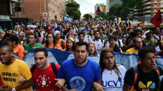 Students demonstrate against the government of Venezuelan President Nicolas Maduro in the streets of Caracas, 3 November 2016