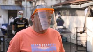 Sergio Sanchez is seen during BBC interview, where face shield is worn