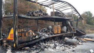 The burned out lorry and trailer