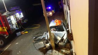 The car crashed into a lamp-post