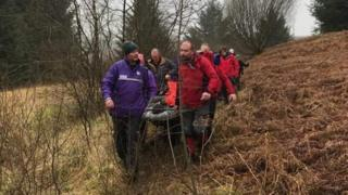 Rescuers with stretcher