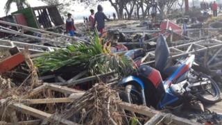 People walk among debris in Palu. Photo: 29 September 2018