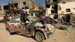 Fighters loyal to Libya's internationally recognised government celebrate in the street of Benghazi after taking control of Islamist areas (23 February 2016)
