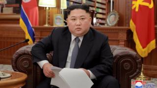Kim Jong-un in an armchair giving his New Year's speech