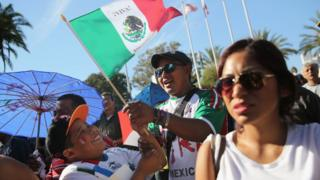 People sing the Mexican national anthem during the opening ceremony of the sixth annual Mole Fair on October 6, 2013 in Los Angeles, California.
