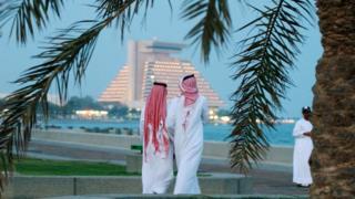 Men walk along Doha corniche (file photo)