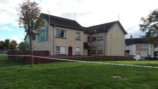 Police have cordoned off the flat in Dingwell Park where the man's body was discovered