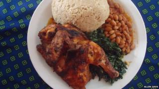A meal at Gava's Restaurant, chicken, beans, sadza, and green vegetables