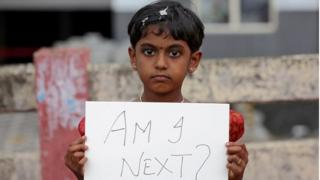 girl holds a placard during a protest against the rape of an eight-year-old girl in Kathua, near Jammu, in Kochi, India April 15, 2018.