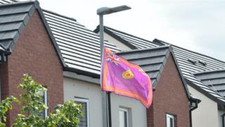 An Ulster Volunteer Force flag hanging from a lamp post in Belfast
