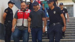 Atilla Taş gözaltına alınırken