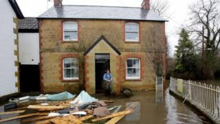Holly Baillie-Grohman looks at flood damage in the village of Thorney, in Somerset