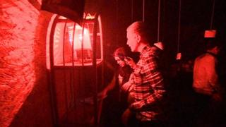 People taking part in an escape game