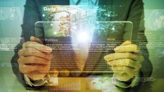 Man holding glass tablet with news stories graphic