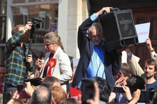 Labour leader Jeremy Corbyn holds up a speaker so the crowd can hear a speech by the party's local candidate Rachael Maskell during a rally in St Helen's Square, York on 10 May 2017.