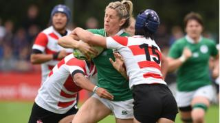 Alison Miller of Ireland is tackled by Mayu Shimizu of Japan during the Womens Rugby World Cup 2017