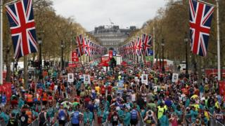London Marathon runners collect their medals