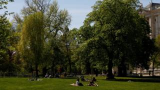 People sit in a park in Vienna