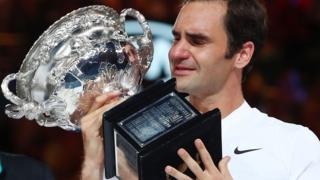 Roger Federer holds the Australian Open trophy