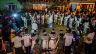 """Afro-Colombians dance """"Fuga"""" (Traditional dance) during the """"Adoraciones al Nino Dios"""" celebrations, in Quinamayo, department of Valle del Cauca, Colombia, on February 18, 2018."""
