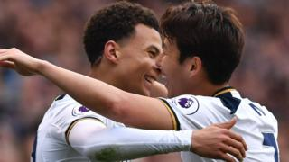 Dele Alli and Son celebrate