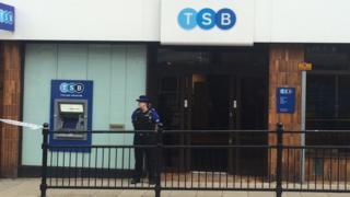 A police officer outside the Lloyds TSB bank in Horden