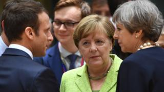 French President Emmanuel Macron (L), German Chancellor Angela Merkel and British Prime Minister Theresa May in Brussels, 22 Jun 17