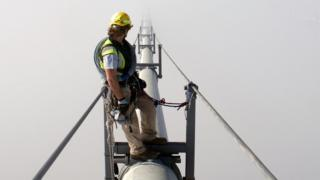 Rope access technician on Forth Road Bridge