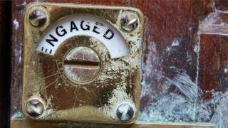 Engaged sign on public toilet door