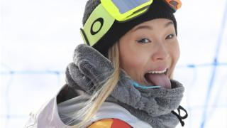 Chloe Kim reacts after her successful run at the Winter Olympics