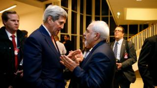 In this Jan. 16, 2016 file-pool photo, Secretary of State John Kerry talks with Iranian Foreign Minister Mohammad Javad Zarif in Vienna, after the International Atomic Energy Agency (IAEA)