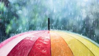 Heavy rain on an umbrella